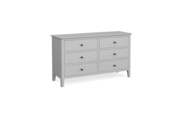 A pale grey six drawer chest of drawers.